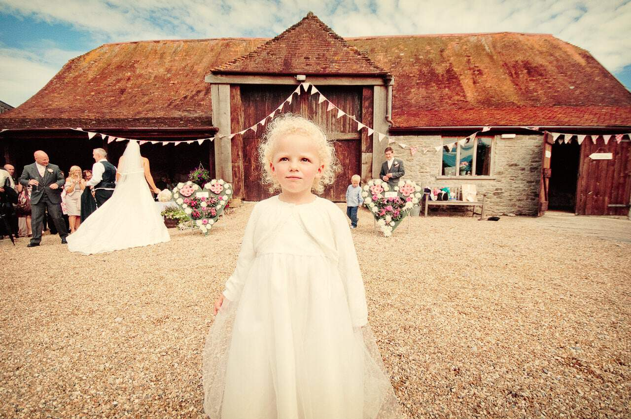 Flower girl at Stockbridge Farm Barn wedding venue in Dorset photo