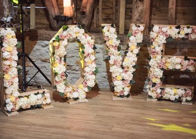 Giant wedding LOVE letters filled with flowers at Stockbridge Farm Barn