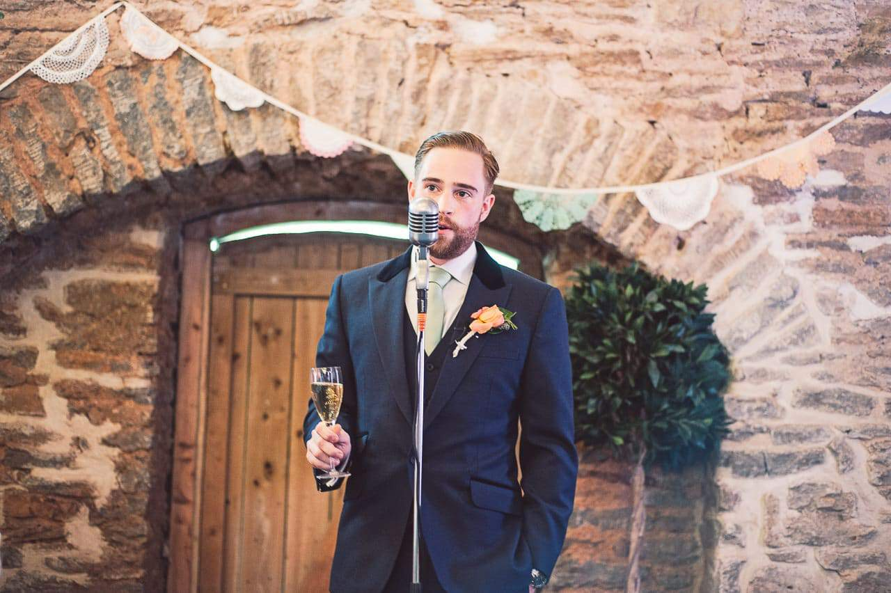 Groom gives wedding speech at Stockbridge Farm Barn photographers