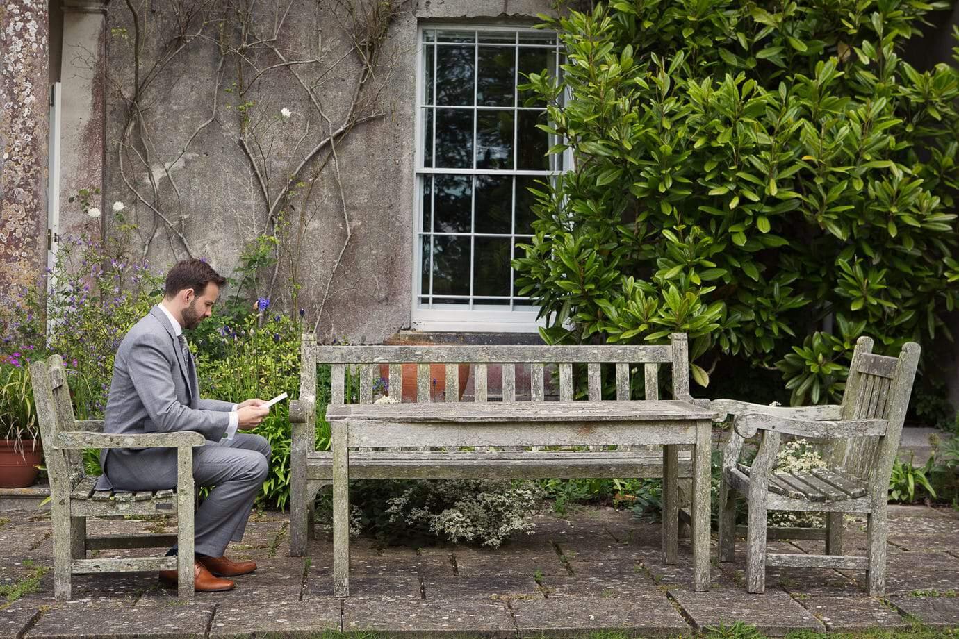 Groom practices wedding speech on at Plush Manor wedding venue in Dorset