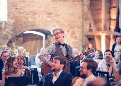 Guest performs song at Stockbridge Farm Barn wedding breakfast