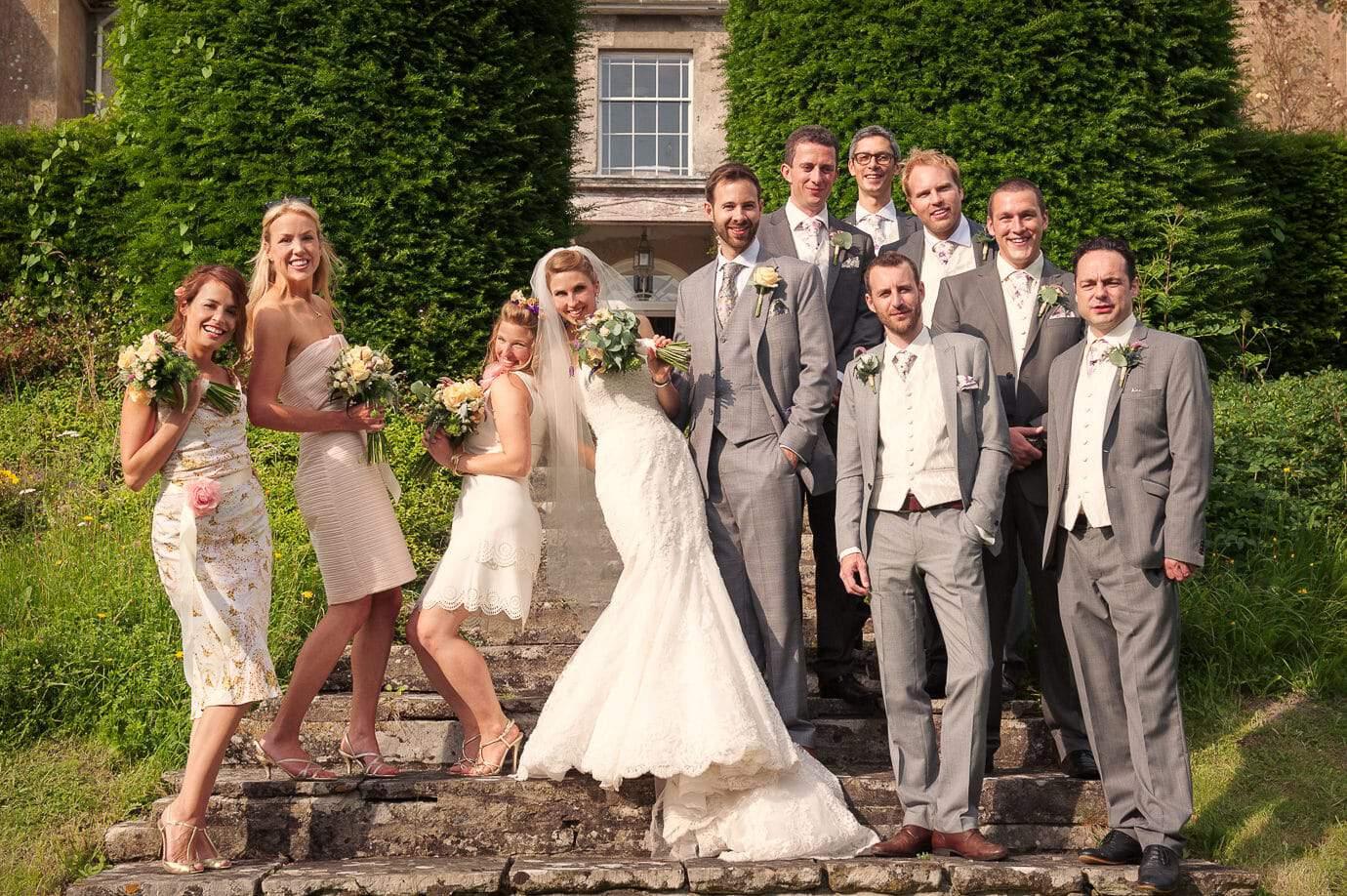 Informal wedding group photograph outside Plush Manor wedding venue