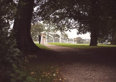 Lulworth Castle grounds with bride and groom at Lulworth Castle Wedding