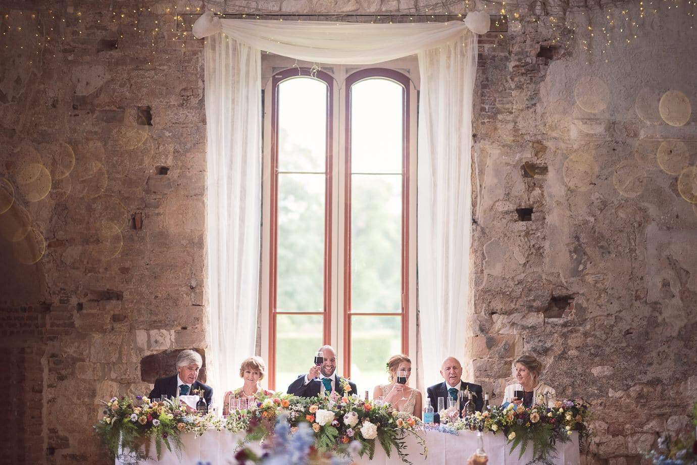 Lulworth Castle Wedding Top Table during wedding breakfast photographs