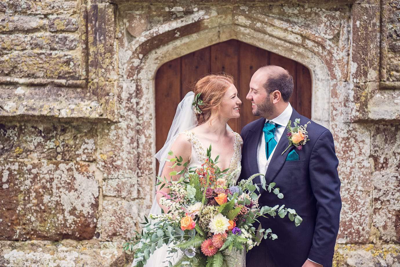 Lulworth Castle wedding venue bride and groom couple photograph