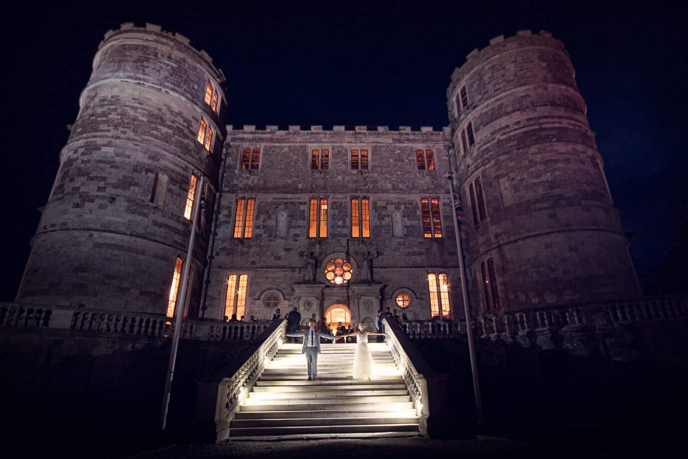 Lulworth Castle wedding venue photographers capture Lulworth wedding at night