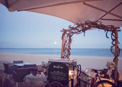 Moon rising over the sea and beach at Sandbanks Hotel wedding venue in Dorset
