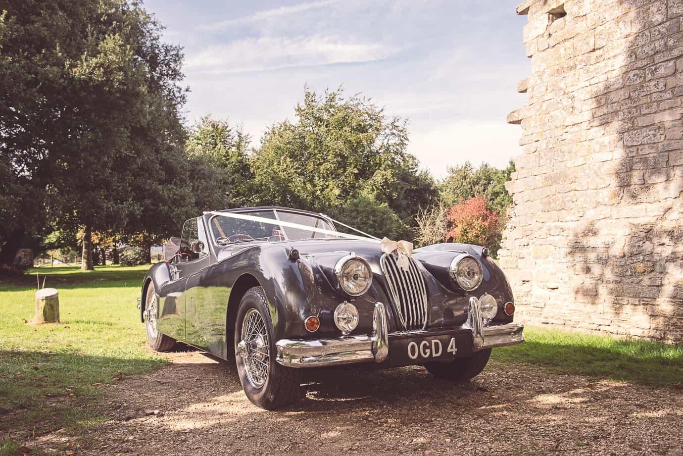 Classic Jaguar wedding car photo by Lulworth Castle wedding photographers