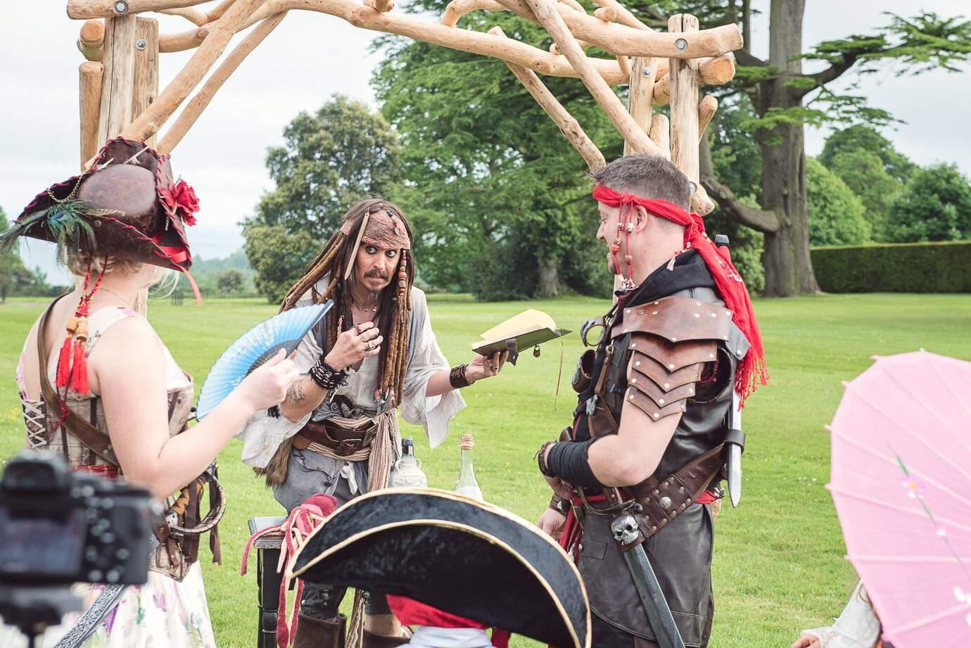 Jack Sparrow outdoor pirate wedding ceremony at Lulworth Castle in Dorset