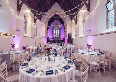 Wedding breakfast set up on old English church at Plush Manor wedding venue