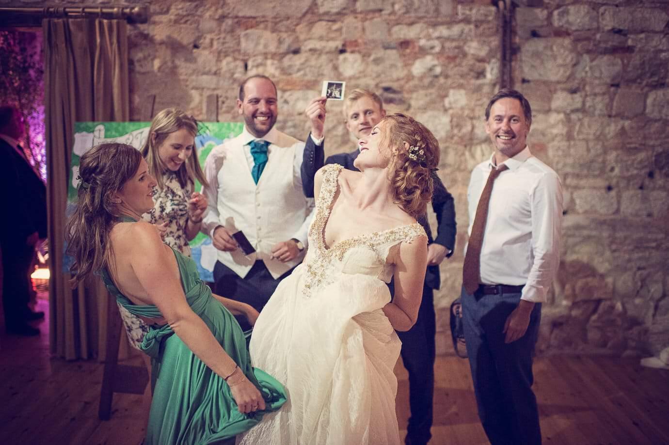 One Thousand Words Lulworth Castle Wedding Photographers photo of bride dancing