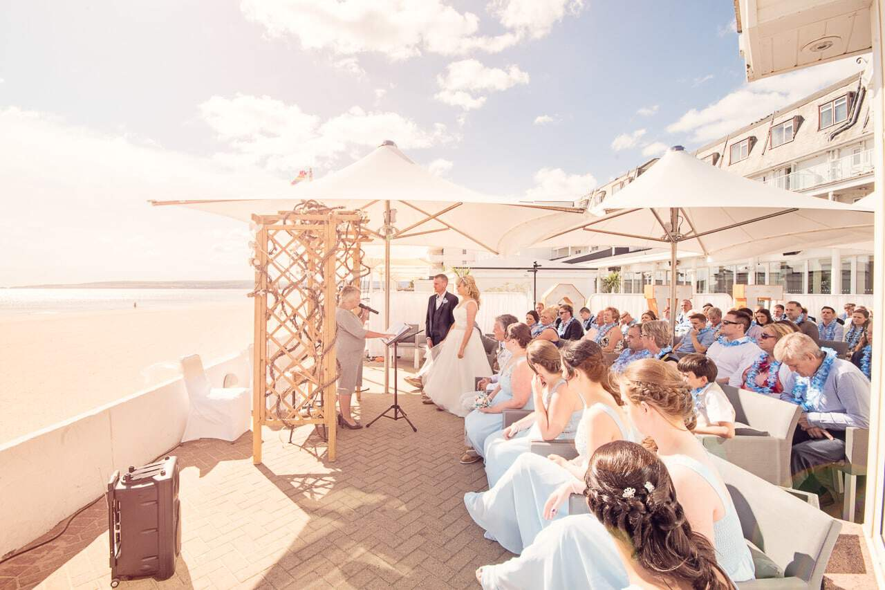 Outdoor beach ceremony wedding photographers at Sandbanks Hotel wedding venue