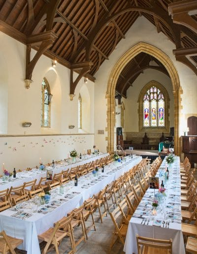 Plush Manor de consecrated church set up for wedding breakfast with banquet tables