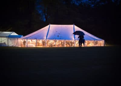 Plush Manor wedding photographers capture glowing wedding marquee in the rain