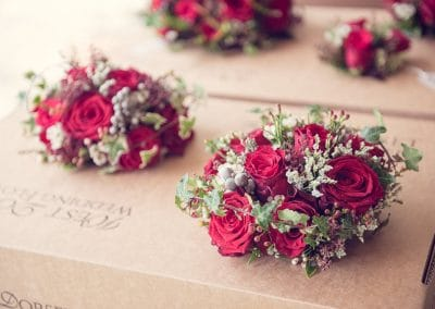 Red rose wedding bouquets by West Dorset Wedding Flowers at Plush Manor