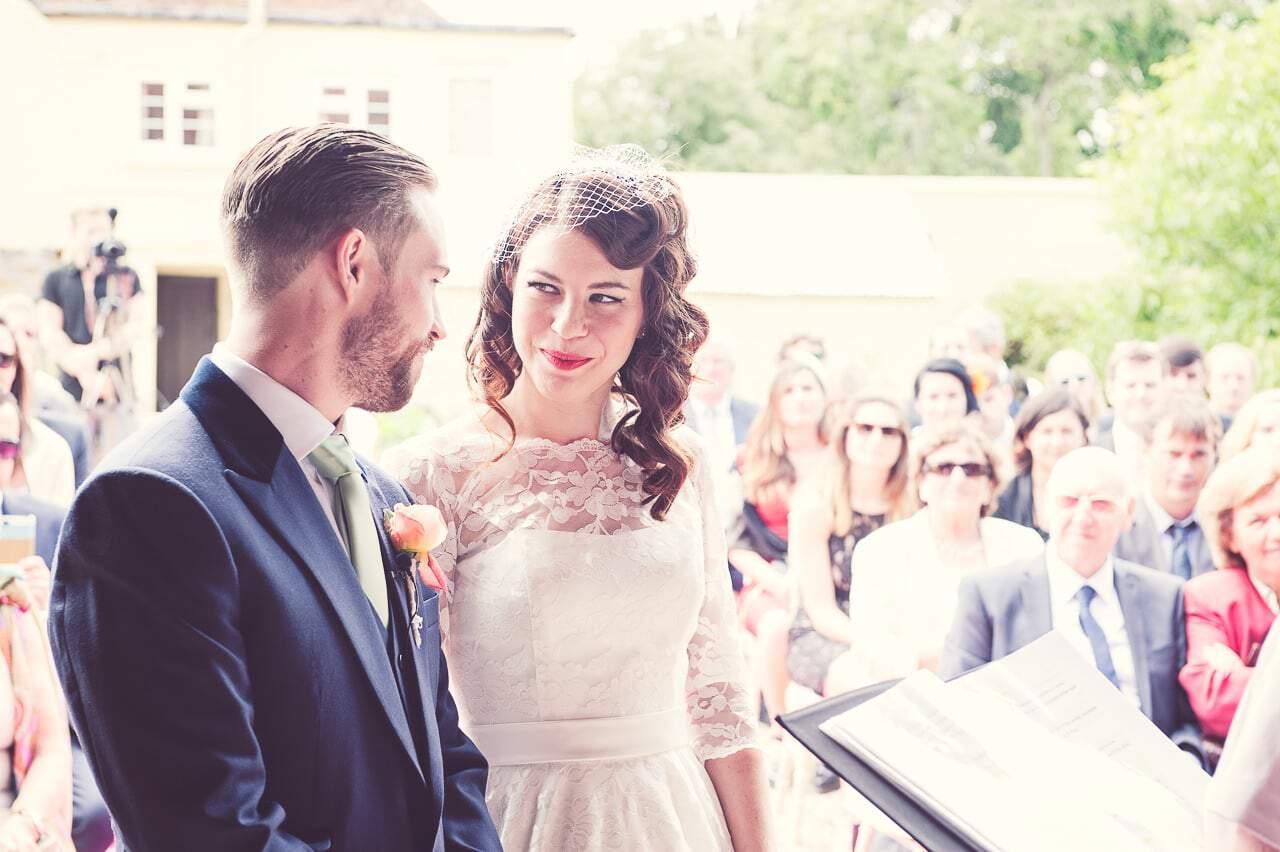 Retro bride and groom at Stockbridge Farm Barn wedding ceremony