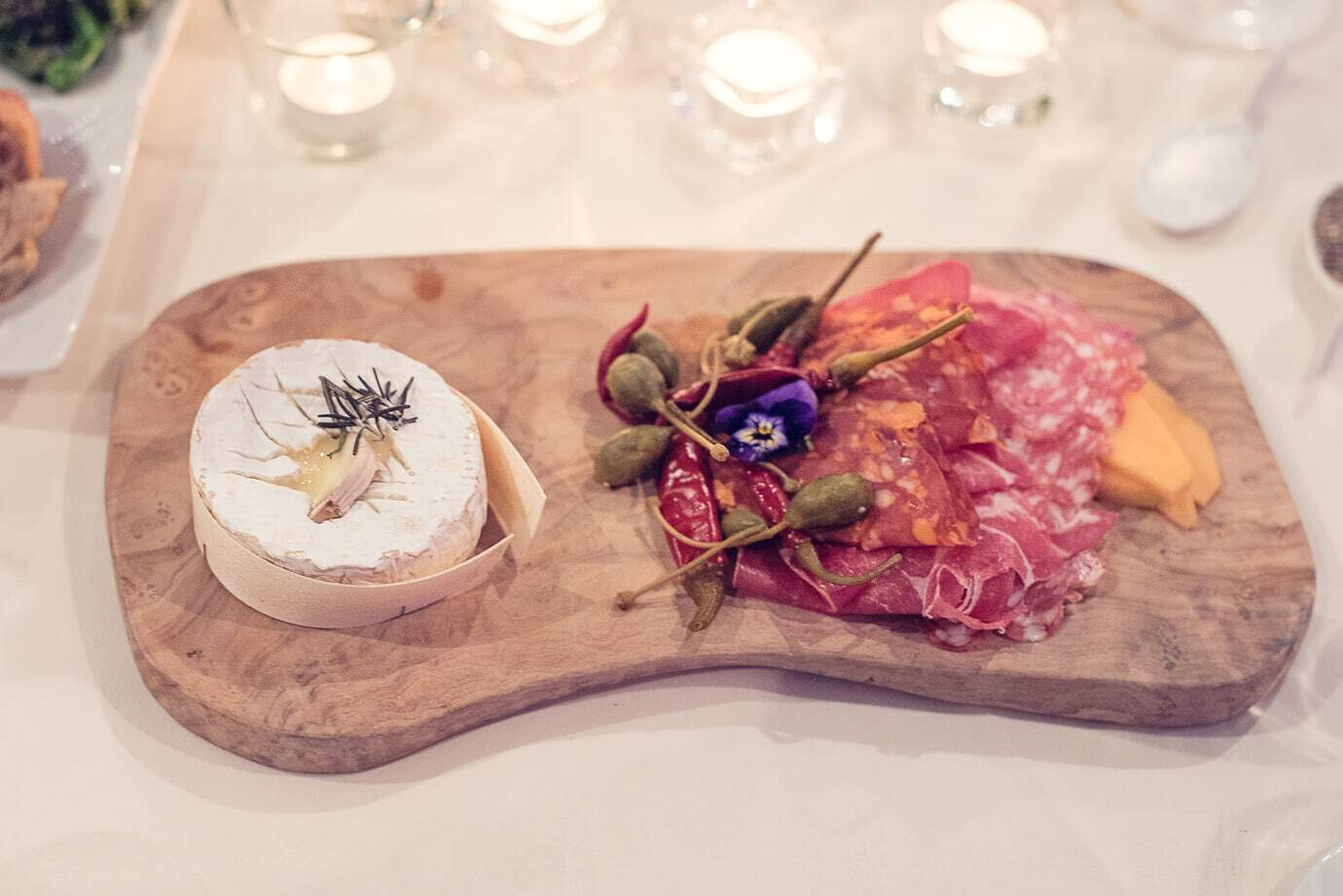Roasted Camembert with caper berries and meats wedding starters at Plush Manor