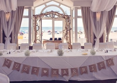 Sandbanks Hotel sea side themed top table at Sandbanks Hotel wedding venue