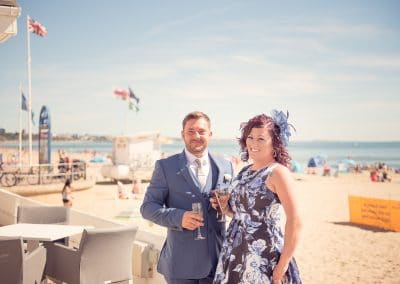 Sandbanks Hotel wedding guests by the beach in the Dorset summer sun