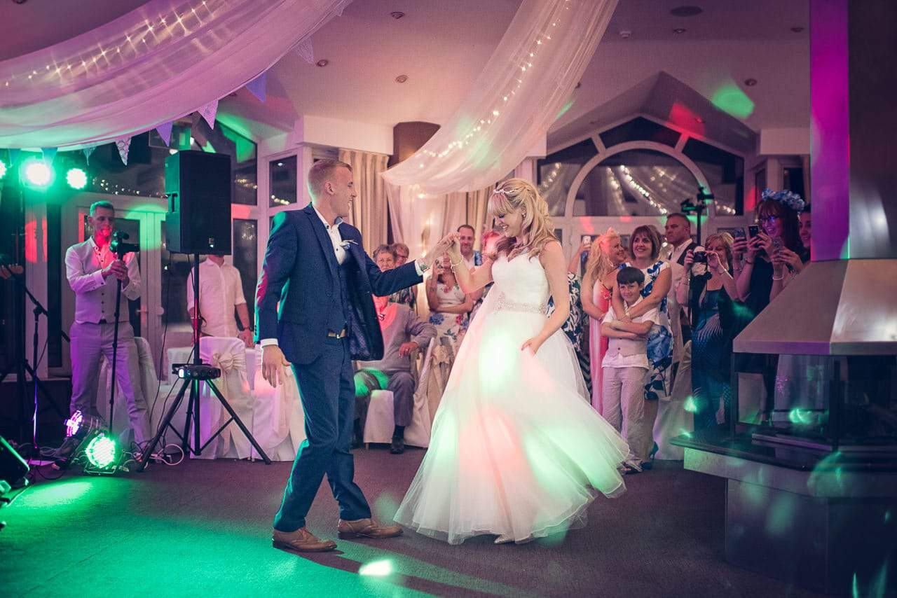 Sandbanks Hotel Wedding venue photograph first dance under disco lights