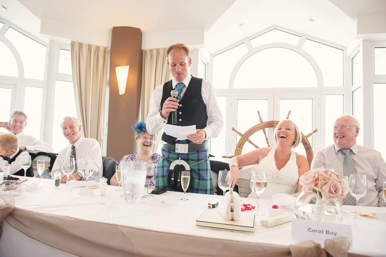 Sandbanks Hotel Wedding venue kilted wedding speeches in Compass suite
