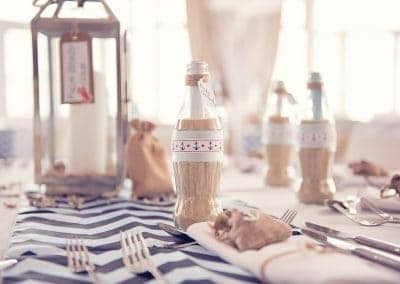 Seaside themed wedding decoration message in a bottle at Sandbanks Hotel Dorset