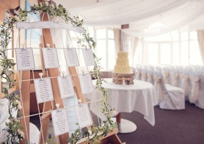 Seaside wedding venue decorated table plan at Sandbanks Hotel wedding venue