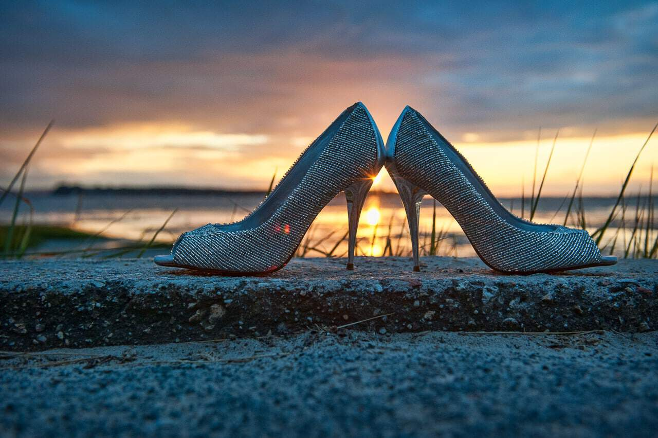 silver beaded wedding shoes with sunset over sea at Sandbanks Hotel Wedding