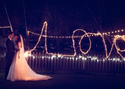 Sopley Mill wedding photographers capture sparklers love writing