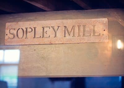Sopley Mill wedding venue in Dorset original metal name sign preserved in mill workings