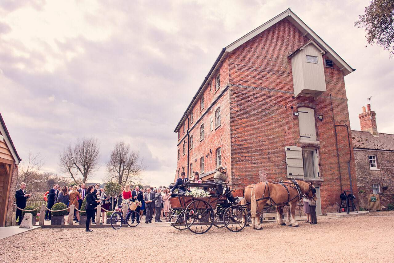 Sopley Mill wedding venue in Dorset with wedding horses and carriage