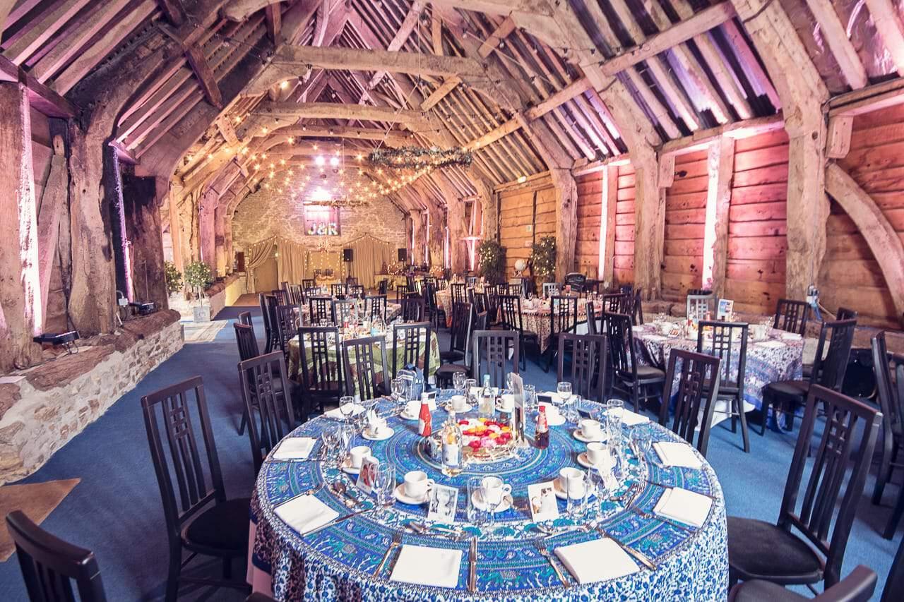 Stockbridge Farm Barn photograph of wedding breakfast setup inside