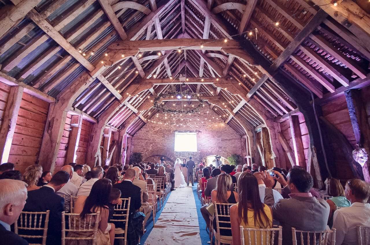 Stockbridge Farm Barn wedding ceremony under wooden beams
