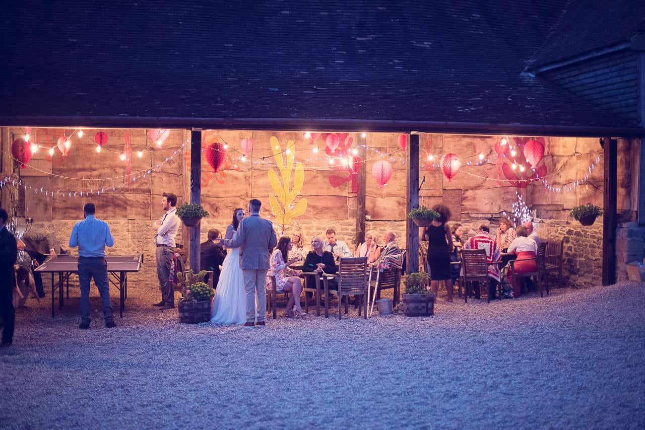 Stockbridge Farm Barn wedding venue outside space lit at night