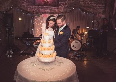 Wedding cake cutting at Stockbridge Farm Barn wedding venue photo