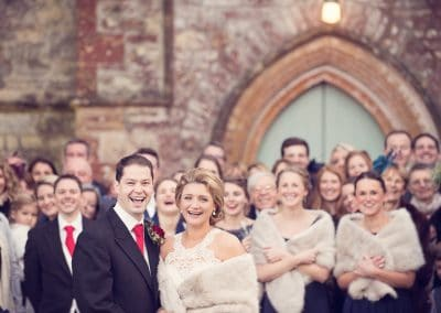 Wedding group photograph by recommended Plush Manor wedding photographers