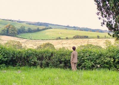 Wedding guest enjoys Plush Manor wedding venue Dorset countryside hill views