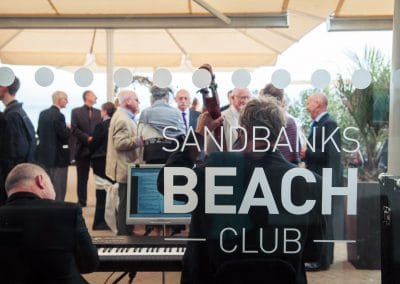 Wedding musicians on sun terrace outside Sandbanks Beach Club wedding reception