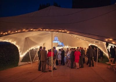 Wedding stretch tent with lampshades and LEDs at Plush Manor evening reception