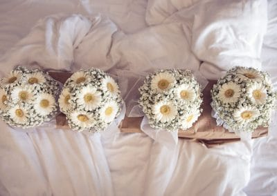 White and yellow wedding flower bouquets at Sandbanks Hotel wedding venue