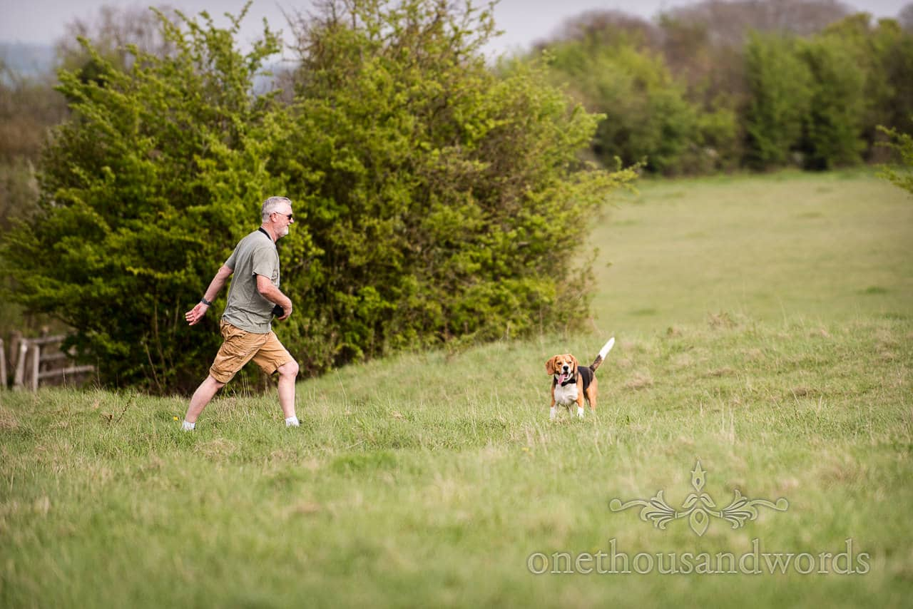 Buddy the beagle with one of his humans at Badbury Rings Engagement Photographs