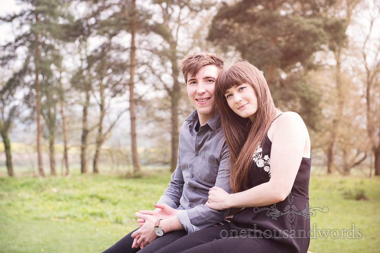 Engaged couple hold hands during Badbury Rings Engagement Photographs