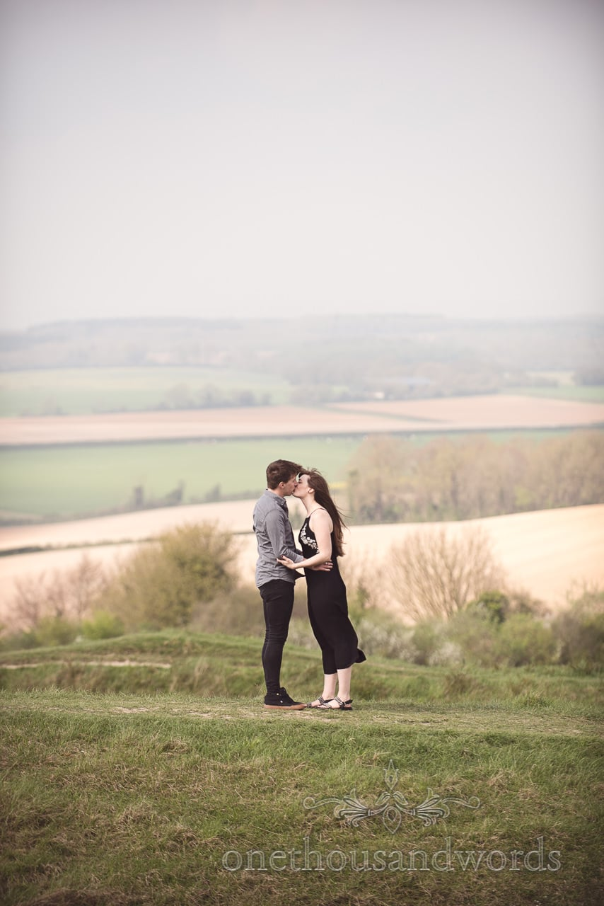 Kissing couple from Badbury Rings Engagement Photographs