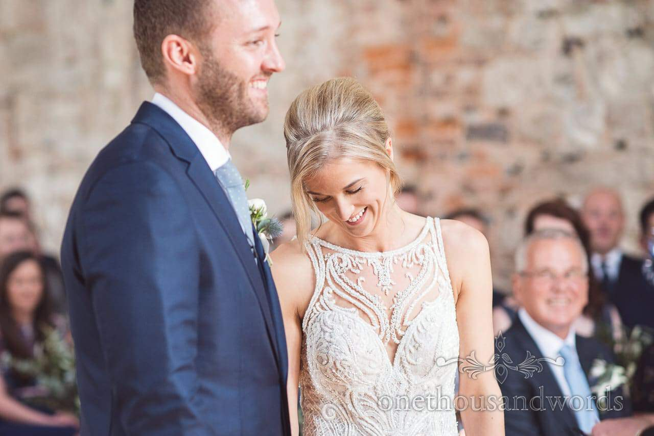 Beautiful Bride and groom coy smiles at Lulworth Castle Wedding Photos