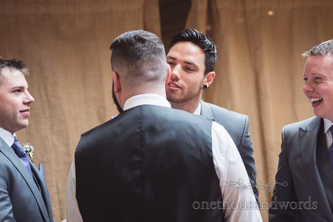 Best man and groom share a joke before at the Tithe Barn Symondsbury Wedding