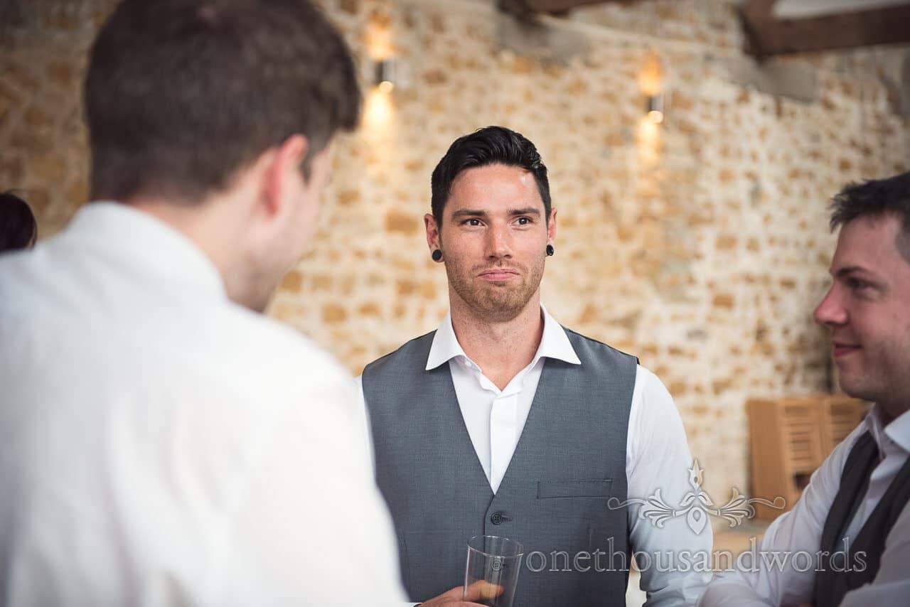 Best man during reception at Tithe Barn Symondsbury Wedding