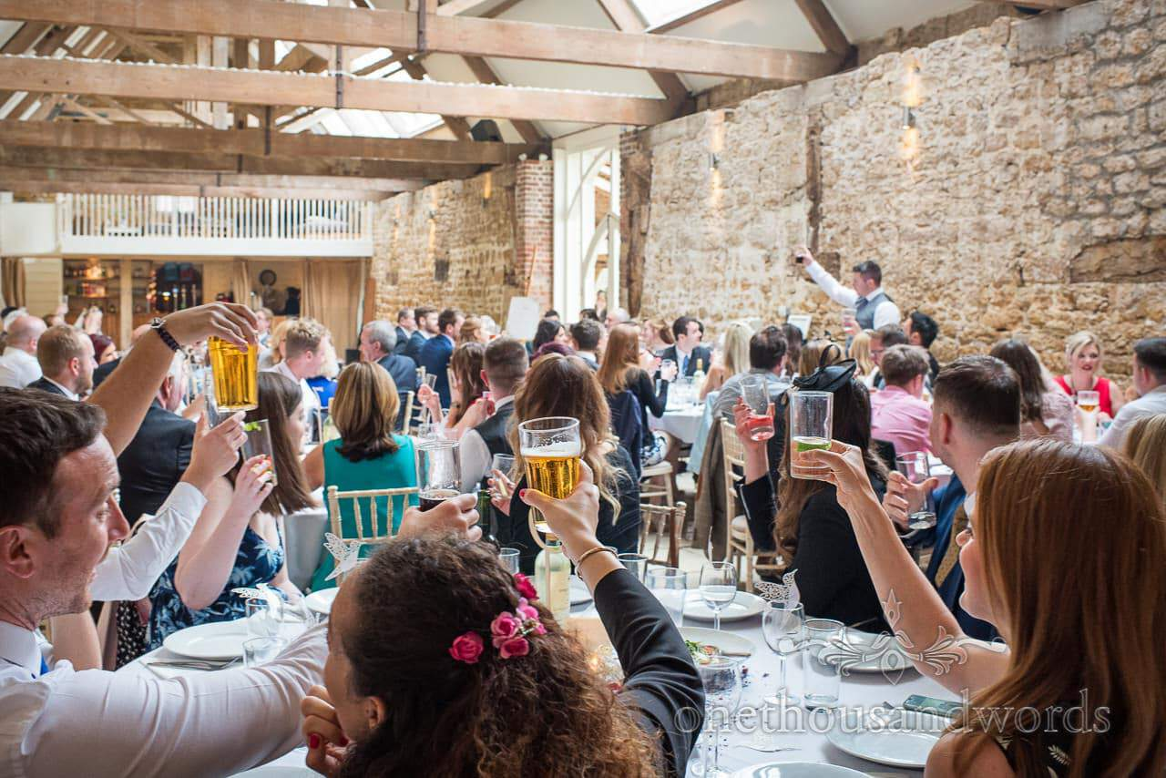 Best man raises a toast to complete speeches at Tithe Barn Symondsbury Wedding