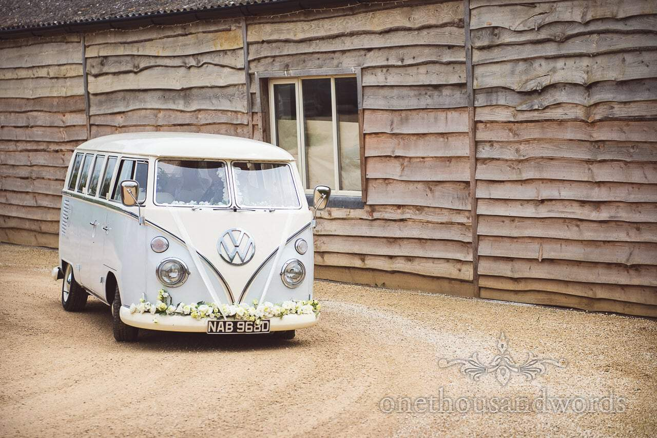 Bridal party arrive in VW bus at the Tithe Barn Symondsbury Wedding
