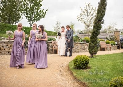 Bridal party make their way to ceremony at the Tithe Barn Symondsbury Wedding