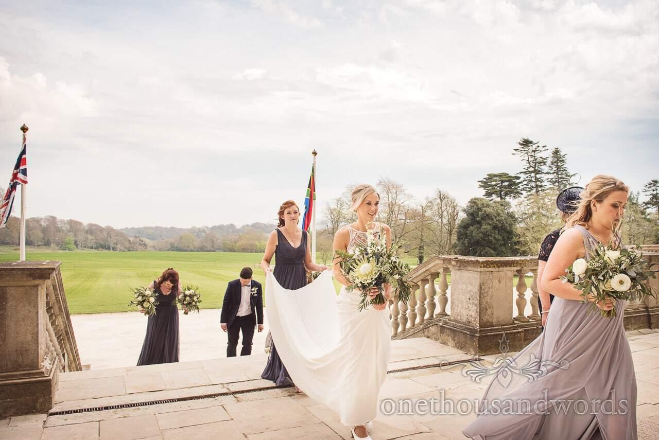 Bride and bridesmaids arrive at Lulworth Castle Wedding venue in Dorset photos